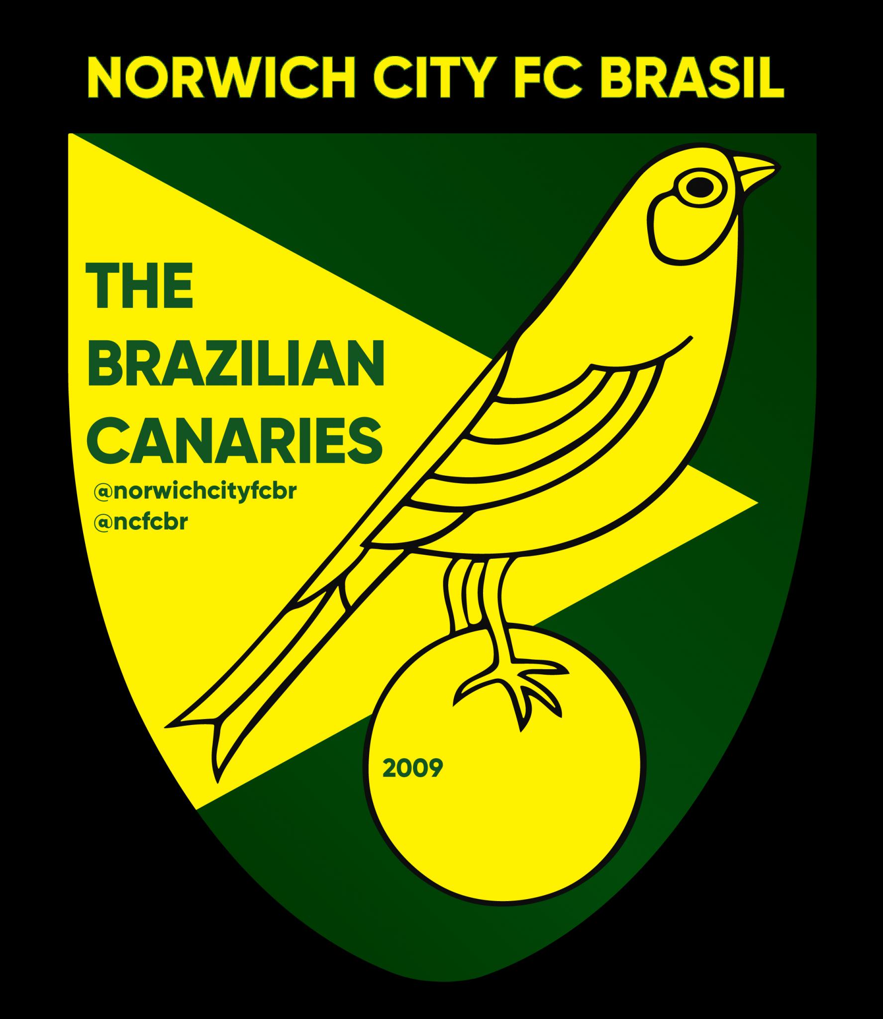 Logo do Norwich City FC: Fundo verde escuro, um losango amarelo com um escudo com um grande canário no centro.